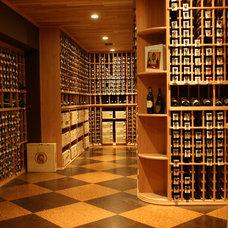 Traditional Wine Cellar by Thomas Baio Architect PC