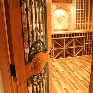 Large classic wine cellar in Orange County with dark hardwood flooring and storage racks.