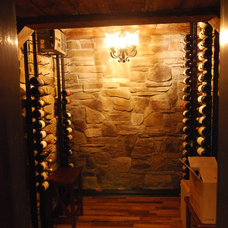 Traditional Wine Cellar by Plan-2-Finish, Inc.