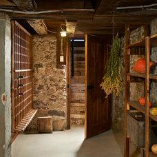 Rustic Wine Cellar by Tucker Construction Ltd.