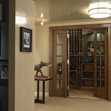 Traditional Wine Cellar by Erotas Building Corporation