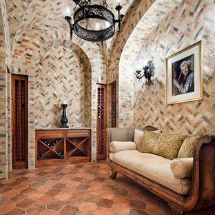 Diseño de bodega mediterránea con suelo de baldosas de terracota y botelleros de rombos
