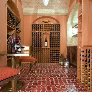 Imagen de bodega mediterránea con botelleros y suelo rojo