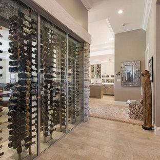 Idéer för en stor klassisk vinkällare, med ljust trägolv och vindisplay
