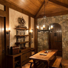 rustic wine cellar by Morgan-Keefe Builders, Inc.