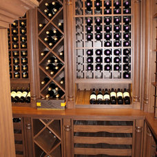 Traditional Wine Cellar by Wm. E. Tyssen Furniture & Millwork Ltd.