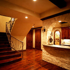mediterranean wine cellar by Alberto Jauregui Designs, Inc.