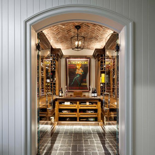 Design ideas for a medium sized bohemian wine cellar in Other with grey floors.
