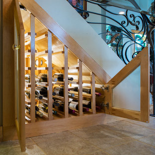 Inspiration for a mediterranean wine cellar remodel in Orange County