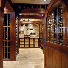 Traditional Wine Cellar by Kotzen Interiors, LLP