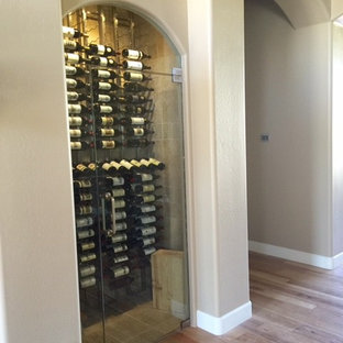 Design ideas for a medium sized contemporary wine cellar in Phoenix with travertine flooring and storage racks.