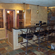 Contemporary Wine Cellar by Edgework Builders, Inc.
