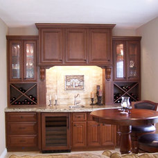 Traditional Wine Cellar by UNIQUE WOODWORKS