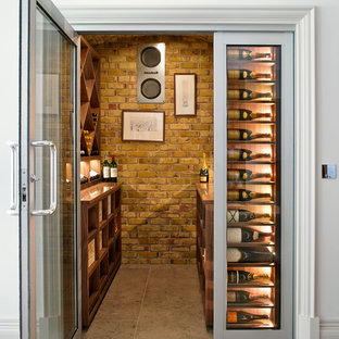 Inspiration for a classic wine cellar in London with display racks.