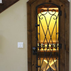 Traditional Wine Cellar by Cabinet Experts
