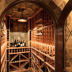 mediterranean wine cellar by Advanced Renovations, Inc.