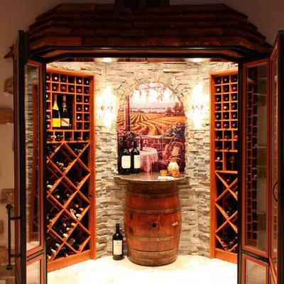 Inspiration for a mediterranean beige floor wine cellar remodel in Los Angeles with diamond bins