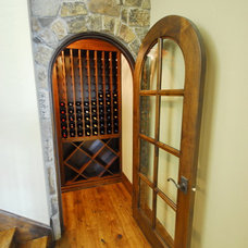 Traditional Wine Cellar by B&B Builders