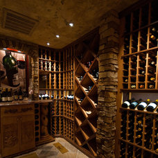 Traditional Wine Cellar by Bozich Construction