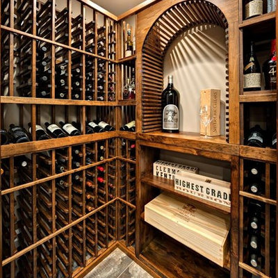 Example of a large arts and crafts wine cellar design in Minneapolis with storage racks