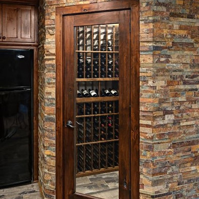 Large arts and crafts wine cellar photo in Minneapolis with storage racks