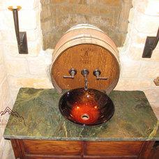 Mediterranean Wine Cellar by Custom Marble & Granite