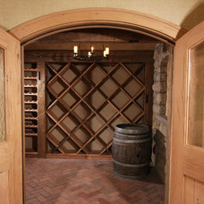 Traditional Wine Cellar by Daniel Contelmo Architects