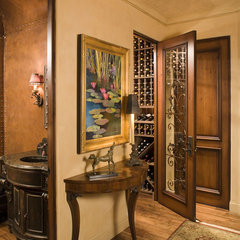 mediterranean wine cellar by Susan Hoffman Interior Designs