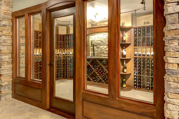 Traditional Wine Cellar by Silent Rivers Design+Build