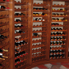 Traditional Wine Cellar by Gabberts Design Studio