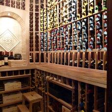 Traditional Wine Cellar by Gabberts Design Studio