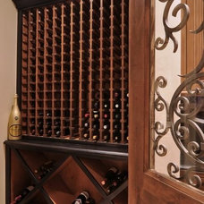 Mediterranean Wine Cellar by Goodall Custom Cabinetry