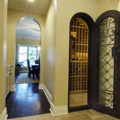 mediterranean wine cellar by Gritton & Associates Architects