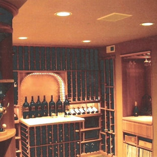 Expansive classic wine cellar in Seattle with ceramic flooring and display racks.