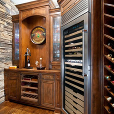Traditional Wine Cellar by LGB Interiors