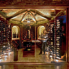Traditional Wine Cellar by Luxury Home Solutions
