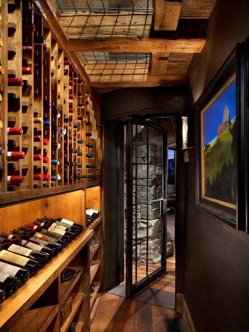 Wonderful Wine Cellar Paint Colors #1: Rustic Dark Wood Floor And Brown Floor Wine Cellar Idea In Atlanta With  Storage Racks