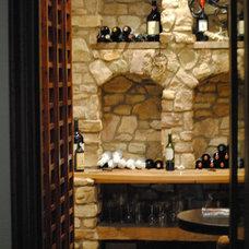 Mediterranean Wine Cellar by Prestige Mouldings & Construction, Inc.