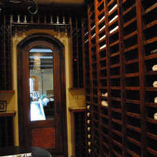 Mediterranean Wine Cellar by Prestige Mouldings & Construction, Inc.