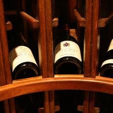 Mediterranean Wine Cellar by Berriz Design Build Group