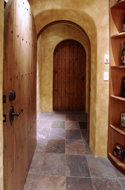 Traditional Wine Cellar by Daniel Gordon | Renovation Artistry