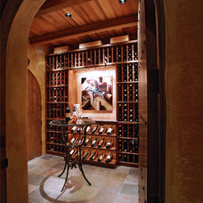Traditional Wine Cellar by Daniel Gordon | Renovation Artistry