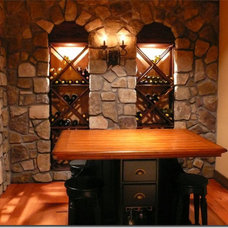 Traditional Wine Cellar by Restoraid Remodeling and Disaster Recovery