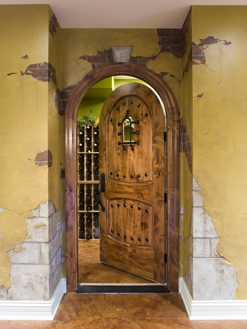 Inspiration for a mid-sized timeless concrete floor wine cellar remodel in Chicago with storage & Speakeasy Window | Houzz