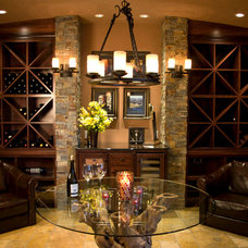 Mediterranean Wine Cellar by MCM Construction Inc