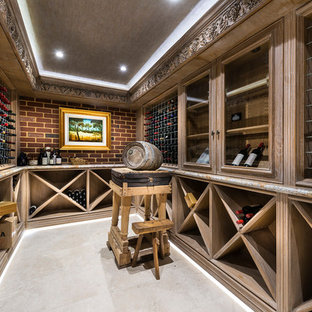 This is an example of a large mediterranean wine cellar in Perth with slate floors and display racks.