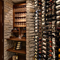 Traditional Wine Cellar by Steven Cabinets