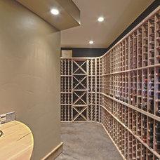 Modern Wine Cellar by Teton Heritage Builders