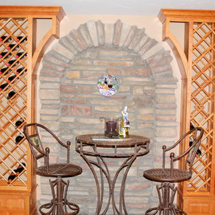 Foto de bodega clásica, de tamaño medio, con suelo de madera en tonos medios y botelleros de rombos