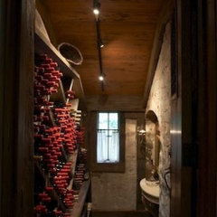 traditional wine cellar by Tracery Interiors
